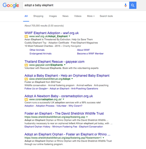Google AdWords ad with description line 1 promoted to the headline